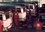 Image of buses in garage United States USA, 1937, second 38 stock footage video 65675051568