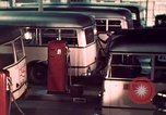 Image of buses in garage United States USA, 1937, second 39 stock footage video 65675051568
