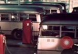 Image of buses in garage United States USA, 1937, second 40 stock footage video 65675051568
