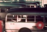 Image of buses in garage United States USA, 1937, second 41 stock footage video 65675051568