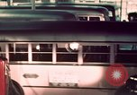 Image of buses in garage United States USA, 1937, second 42 stock footage video 65675051568