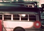 Image of buses in garage United States USA, 1937, second 43 stock footage video 65675051568