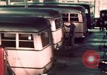 Image of buses in garage United States USA, 1937, second 44 stock footage video 65675051568