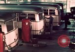 Image of buses in garage United States USA, 1937, second 46 stock footage video 65675051568