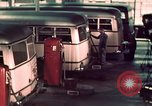 Image of buses in garage United States USA, 1937, second 48 stock footage video 65675051568