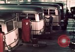 Image of buses in garage United States USA, 1937, second 49 stock footage video 65675051568