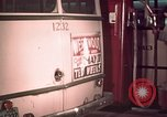 Image of buses in garage United States USA, 1937, second 54 stock footage video 65675051568