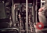 Image of buses in garage United States USA, 1937, second 55 stock footage video 65675051568