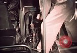 Image of buses in garage United States USA, 1937, second 56 stock footage video 65675051568