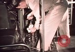 Image of buses in garage United States USA, 1937, second 58 stock footage video 65675051568