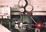 Image of buses in garage United States USA, 1937, second 7 stock footage video 65675051569