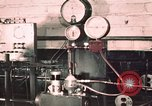 Image of buses in garage United States USA, 1937, second 9 stock footage video 65675051569