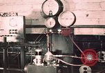 Image of buses in garage United States USA, 1937, second 10 stock footage video 65675051569