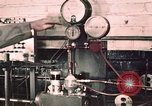 Image of buses in garage United States USA, 1937, second 11 stock footage video 65675051569