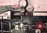 Image of buses in garage United States USA, 1937, second 16 stock footage video 65675051569