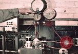 Image of buses in garage United States USA, 1937, second 17 stock footage video 65675051569