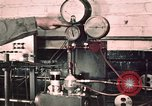 Image of buses in garage United States USA, 1937, second 18 stock footage video 65675051569