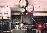 Image of buses in garage United States USA, 1937, second 22 stock footage video 65675051569