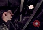 Image of buses in garage United States USA, 1937, second 32 stock footage video 65675051569