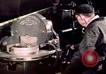 Image of buses in garage United States USA, 1937, second 48 stock footage video 65675051569