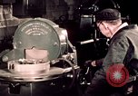 Image of buses in garage United States USA, 1937, second 49 stock footage video 65675051569