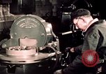 Image of buses in garage United States USA, 1937, second 52 stock footage video 65675051569