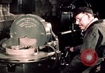 Image of buses in garage United States USA, 1937, second 53 stock footage video 65675051569