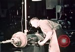 Image of buses in garage United States USA, 1937, second 56 stock footage video 65675051569