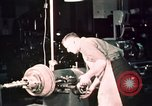 Image of buses in garage United States USA, 1937, second 57 stock footage video 65675051569