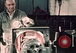 Image of buses in garage United States USA, 1937, second 62 stock footage video 65675051569
