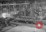 Image of Steel workers silhouetted against fog United States USA, 1943, second 19 stock footage video 65675051747