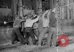 Image of Steel workers silhouetted against fog United States USA, 1943, second 21 stock footage video 65675051747