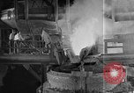 Image of Steel workers silhouetted against fog United States USA, 1943, second 22 stock footage video 65675051747