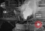Image of Steel workers silhouetted against fog United States USA, 1943, second 23 stock footage video 65675051747