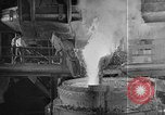Image of Steel workers silhouetted against fog United States USA, 1943, second 24 stock footage video 65675051747