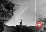Image of Steel workers silhouetted against fog United States USA, 1943, second 25 stock footage video 65675051747