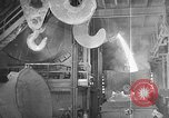 Image of Steel workers silhouetted against fog United States USA, 1943, second 29 stock footage video 65675051747