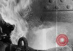 Image of Steel workers silhouetted against fog United States USA, 1943, second 33 stock footage video 65675051747