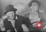 Image of Steel workers silhouetted against fog United States USA, 1943, second 50 stock footage video 65675051747