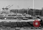 Image of Henry Kaiser demonstrates prefabricated ship assembly United States USA, 1942, second 38 stock footage video 65675051748