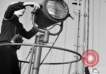 Image of LST communication using semaphore, signal flags, and blinking lights English Channel, 1944, second 6 stock footage video 65675051829