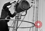 Image of LST communication using semaphore, signal flags, and blinking lights English Channel, 1944, second 8 stock footage video 65675051829