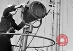 Image of LST communication using semaphore, signal flags, and blinking lights English Channel, 1944, second 9 stock footage video 65675051829