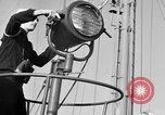 Image of LST communication using semaphore, signal flags, and blinking lights English Channel, 1944, second 10 stock footage video 65675051829
