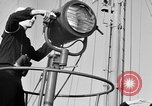 Image of LST communication using semaphore, signal flags, and blinking lights English Channel, 1944, second 11 stock footage video 65675051829