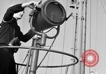 Image of LST communication using semaphore, signal flags, and blinking lights English Channel, 1944, second 13 stock footage video 65675051829