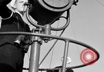 Image of LST communication using semaphore, signal flags, and blinking lights English Channel, 1944, second 15 stock footage video 65675051829