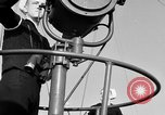 Image of LST communication using semaphore, signal flags, and blinking lights English Channel, 1944, second 17 stock footage video 65675051829