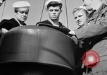 Image of LST communication using semaphore, signal flags, and blinking lights English Channel, 1944, second 42 stock footage video 65675051829