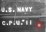 Image of U.S. sailors test fire hose on an LST Portland England United Kingdom, 1944, second 1 stock footage video 65675051842
